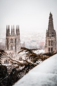 a cathedral shot from an angle slightly above the roofline in snow